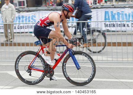 STOCKHOLM SWEDEN - JUL 02 2016: Side view of male triathlete cyclist Adam Bowden in the Men's ITU World Triathlon series event July 02 2016 in Stockholm Sweden