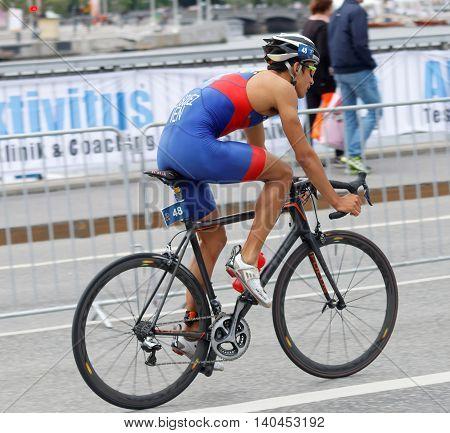 STOCKHOLM SWEDEN - JUL 02 2016: Side view of male triathlete cyclist Luis Miguel Velasques in the Men's ITU World Triathlon series event July 02 2016 in Stockholm Sweden