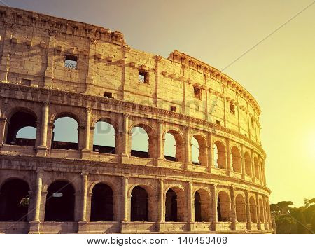 Flavian Amphitheatre or Colosseum in Rome at sunset, Italy