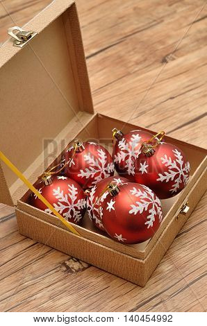 A box full of red baubles to decorate a Christmas tree