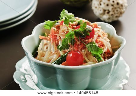 Special salad with tomato and herbs in white bowl