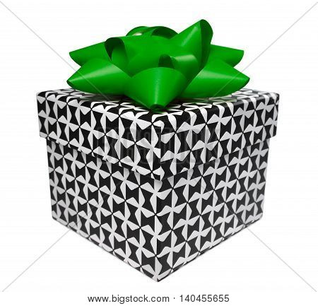 Giftbox with black and white pattern and green bow. Isolated on white.