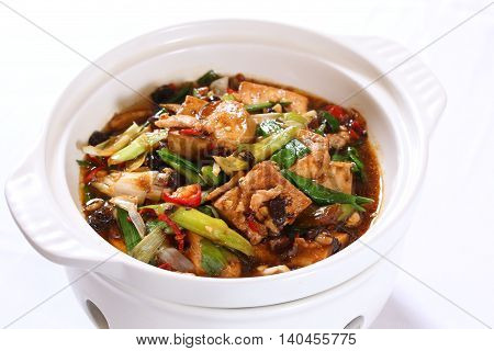 Braised tofu with onion and sauces on white stew