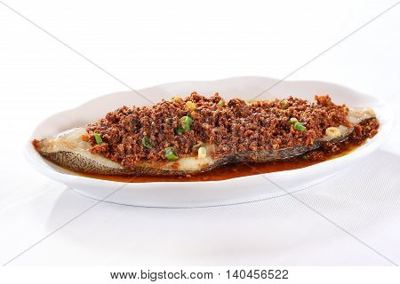 Minced fried beef with a loin of fish on white plate