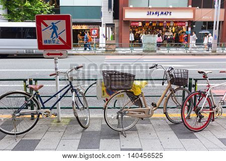 TOKYO JAPAN - 17 July 2016 - Bicycles parks along street of Tokyo on July 17 2016.