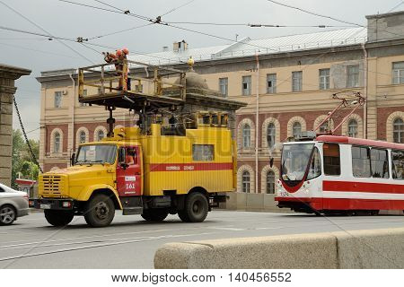 29.07.2016.Russia.Saint-Petersburg.The repair crew fixes damage along the line of movement of trams.