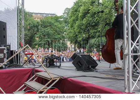 St. Petersburg, Russia - 23 July, The view from behind the scenes, 23 July, 2016. Speech by David Goloschekin with his jazz group on the Arts Square in St. Petersburg.