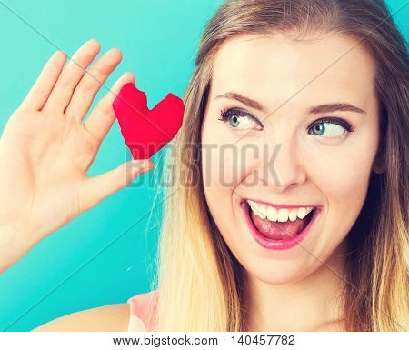 Happy Young Woman Holding A Heart Cushion