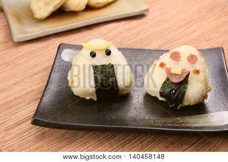 Japanese style grilled rice ball on black plate