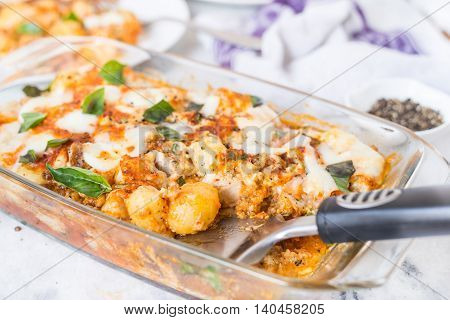 Italian potato and chicken baked recipe on the table