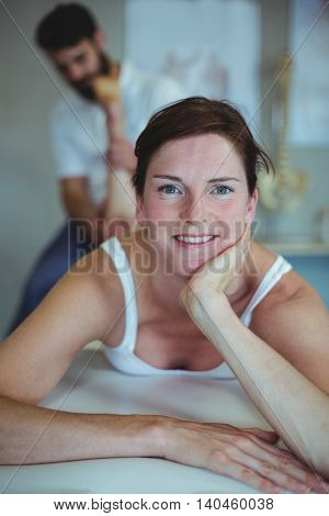 Woman receiving leg massage from physiotherapist in clinic
