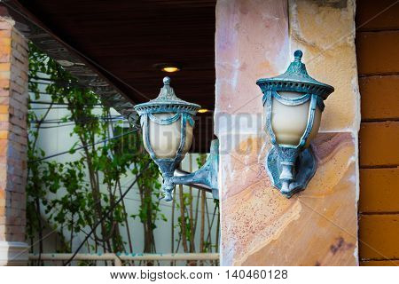 The two lamps on the pole small.