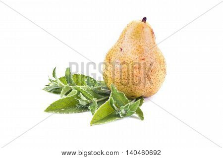 Ripe pear and mint leaves on a white background