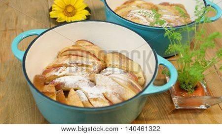 Junior baked apple french toast in white stew on the table