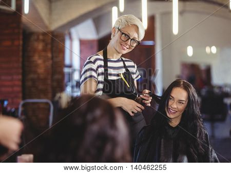 Hairdresser working on the client at the hair salon