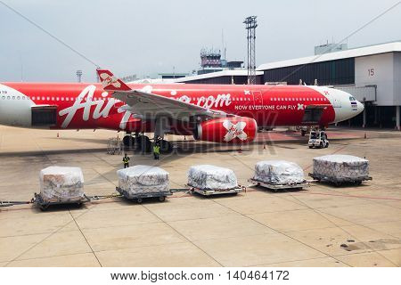 BANGKOK THAILAND - 24 July 2016 - Air Asia airplane waits for luggage cargos to be loaded at Don Mueng International Airport on July 24 2016.