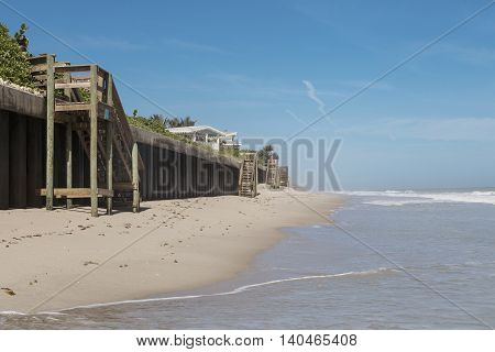 Beach houses and wooden beams and staircase to the beach southern Florida
