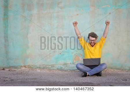 Successful man using a laptop