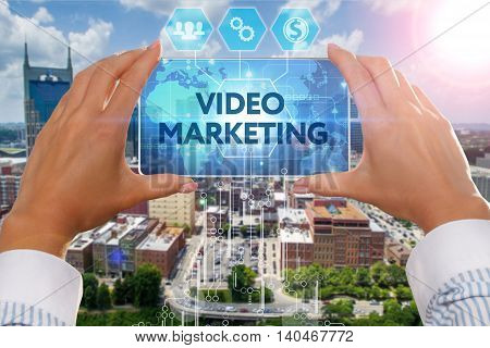 The Girl Looks At A Virtual Screen Of Your Smartphone And See The Inscription : Video Marketing