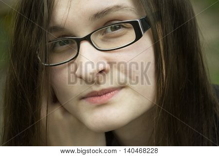Beautiful woman in glasses portrait. Office woman thinks about something