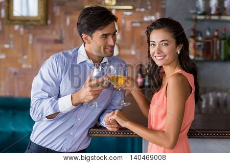 Young couple toasting wine glass in restaurant