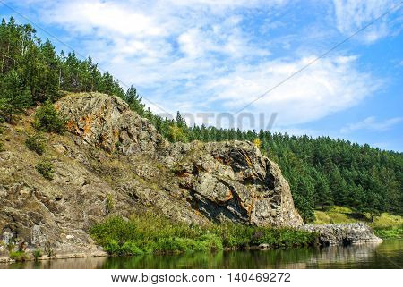 A rock on the Bank of the Ural river Iset