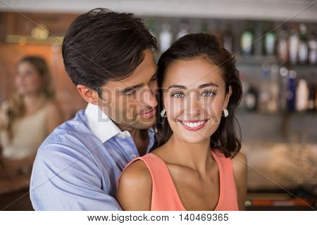 Romantic couple having fun together in restaurant