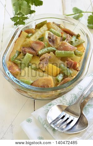 Casserole with potatoes chicken and green string bean, vertical