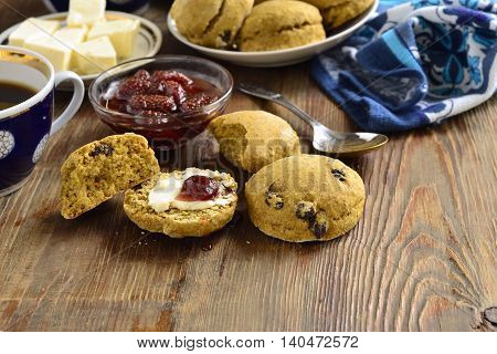 Pumpkin scones with dried fruit for breakfast served with jam and butter