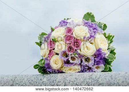 beautiful wedding bouquet of the bride. bouquet of red and white roses on sky background