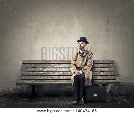 Businessman waiting on a bench