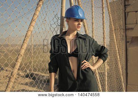 Sensual worker with blue helmet