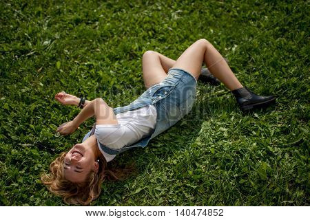 girl lying on the grass and laughing