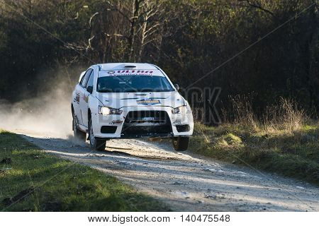 Lviv Ukraine - November 1 2015: Racers Alexey Dolot and Dmytro Kasap on the car brand Mitsubishi Lancer Evo X (No.10) overcome the track at the annual Rally of Galicia near the city of Lviv Ukraine