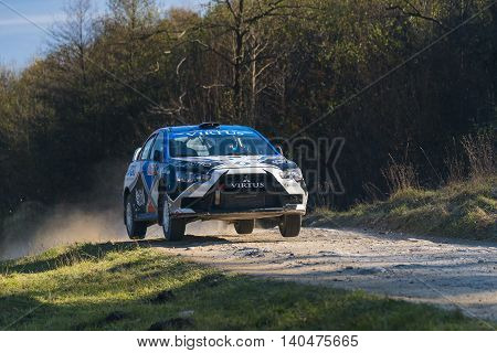 lLviv Ukraine - November 1 2015: Racers Alexey Dolot and Dmytro Kasap on the car brand Mitsubishi Lancer Evo X (No.10) overcome the track at the annual Rally of Galicia near the city of Lviv Ukraine