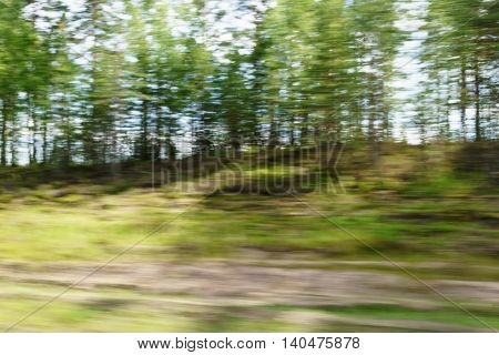 motion blur background of green countryside shot from fast moving car