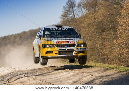 Lviv Ukraine - November 1 2015: Petrenko Volodymyr's Mitsubishi Lancer Evo IX (No. 2) competes at the annual Rally Galicia