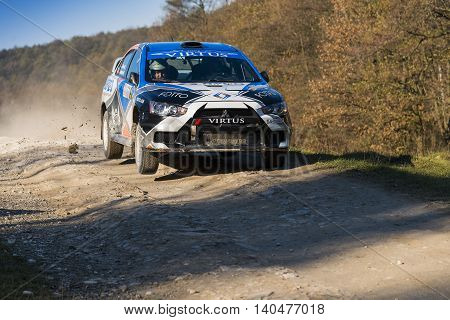 Lviv Ukraine - November 1 2015: Alexey Dolot's Mitsubishi Lancer Evo X competes at the annual Rally Galicia