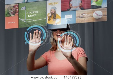technology, virtual reality, cyberspace, entertainment and people concept - happy young woman with virtual reality headset or 3d glasses at home looking at news projection