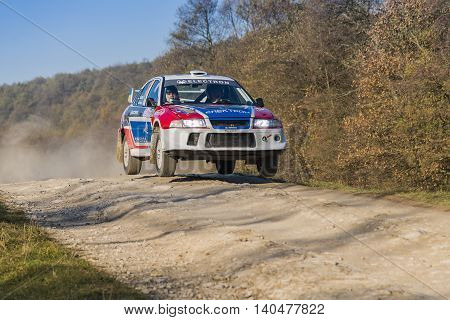 Lviv Ukraine - November 1 2015: Myhailo Syrvetnyk's Mitsubishi Lancer Evo IV (No.12) competes at the annual Rally Galicia