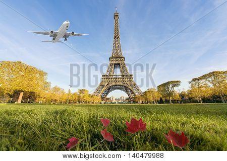 Airplane flying over Eiffel Tower Paris France. Eiffel Tower is international landmark in Paris France