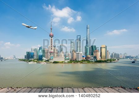 Shanghai skyline in Lujiazui Pudong business center district with airplane at Shanghai China.
