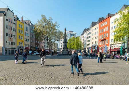 Cologne Germany - May 01 2016: Crowded of people eating meal at Neumarkt square near the church of St. Martin in Cologne Germany.