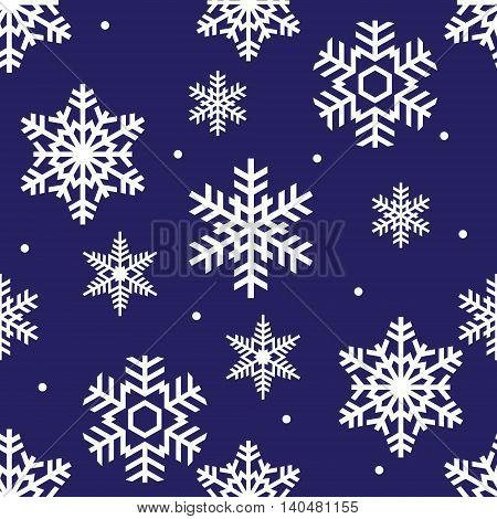 seamless winter pattern of white openwork snowflakes on a blue background