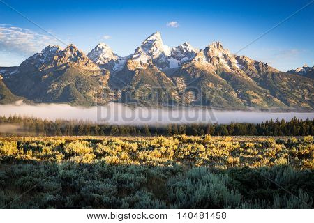 A cool summer morning sunrise overlooking the Grand Teton National Park, Wyoming