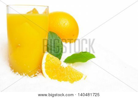 Whole Orange With Juice,ice Cubes And Leaves On Snow On White