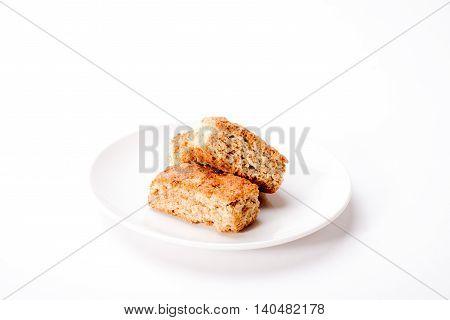 Three Rusks On Plate