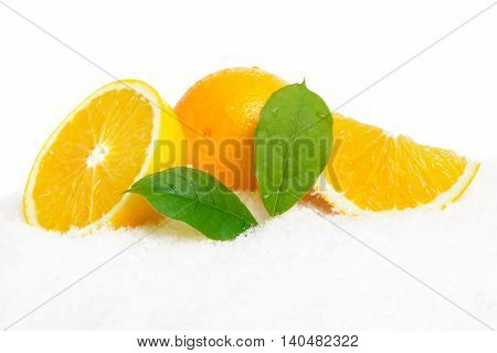 Orange Fruits And Leaves On Ice On White
