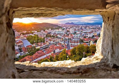 Ljubljana sunset through stone window aerial view capital of Slovenia