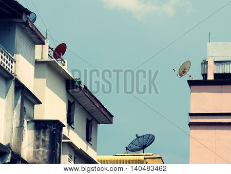 Satellite dishes on city home and buildings to get media signal in film effect